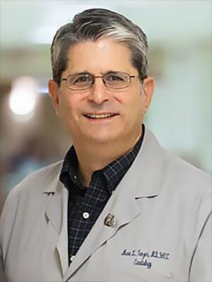 Dr. Marc L. Tenzer