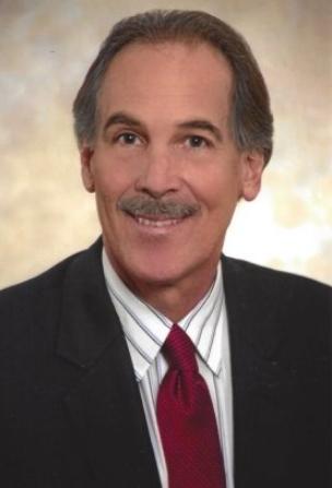 Robert J. DeCurtins - DeCurtins Law Office