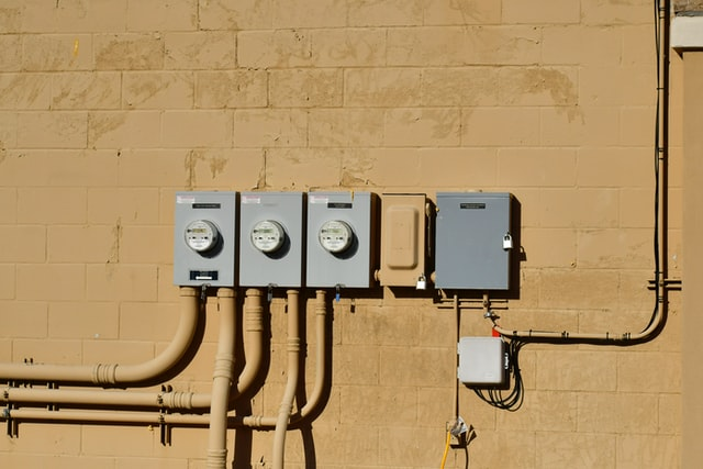 Electrical panels on a wall in a row that have been installed and replaced in Moncks Corner.