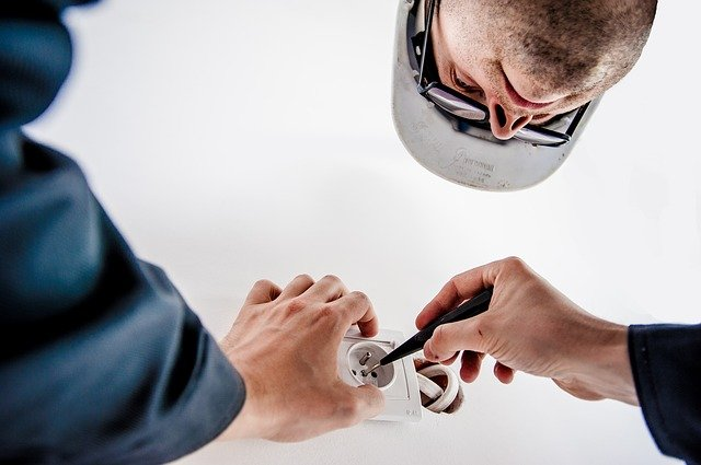An electrician doing GFCI repair in moncks corner South Carolina.