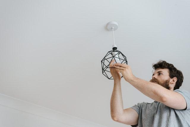 An electrician in Moncks Corner South Carolina fixing a light.