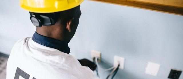 An electrician performing gfci repair.