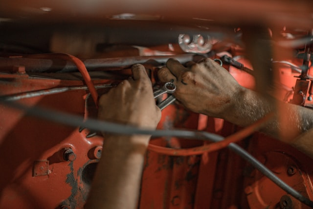 An electrician's hands as he fixes the wires in a service upgrade.