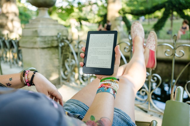 Someone with their legs up reading an ebook from an online store.