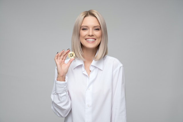 A woman holding cryptocurrency for analysis.