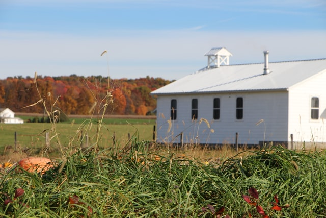 Amish building in a field custom built by a service.
