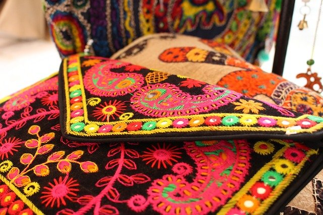 A handmade Indian textile bag in a shop.