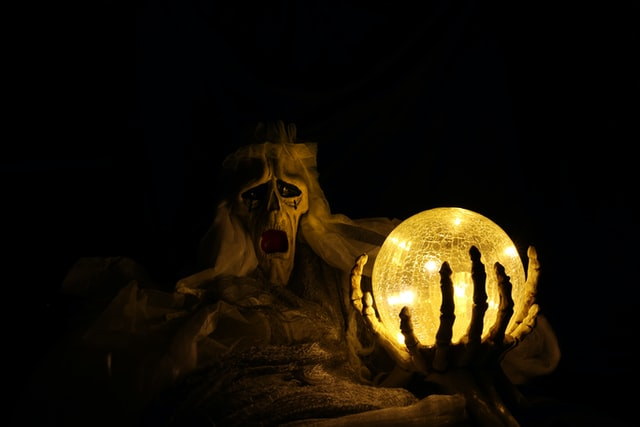 A skeleton ghost holding an orb on a New Orleans ghost tour America.