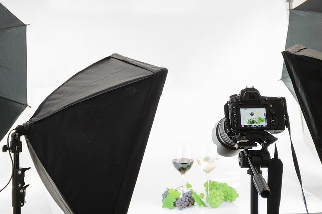 A photo studio with a camera set up taking a 360 degree product photo.