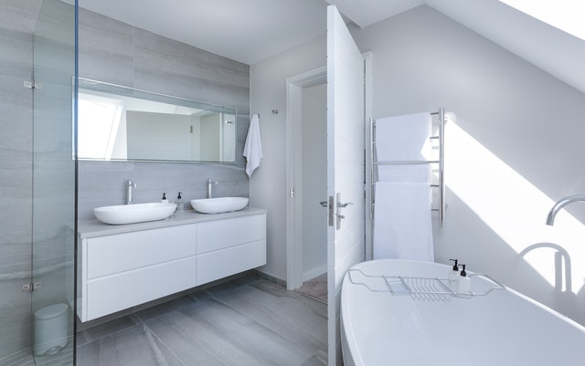 A white bathroom with supplies from a UK online store.