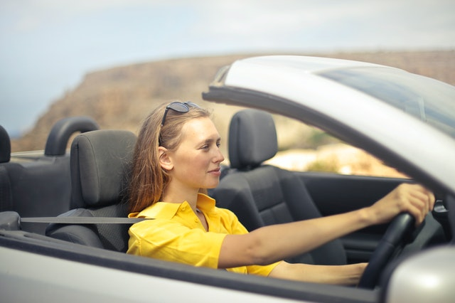 A woman driving a car insured by California auto insurance company.
