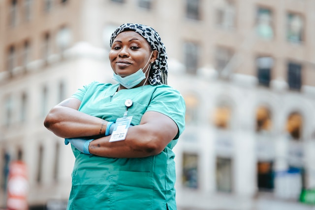 A nurse in Florida in uniform with her arms folded.