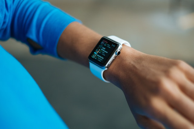 A smart watch and the latest tech from an online store.
