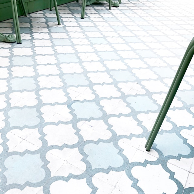 A floor with tiles and mosaics from a store.