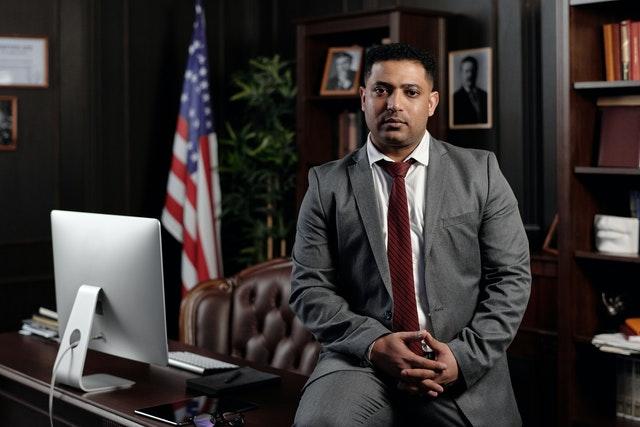 A UAE lawyer sitting on his desk.