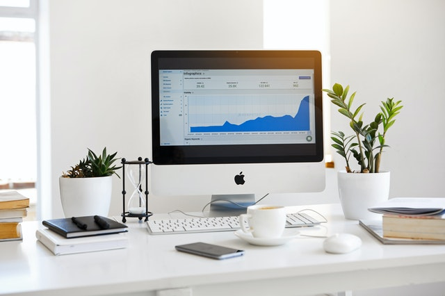 A computer with statistics from a top Charleston USA digital marketing agency.