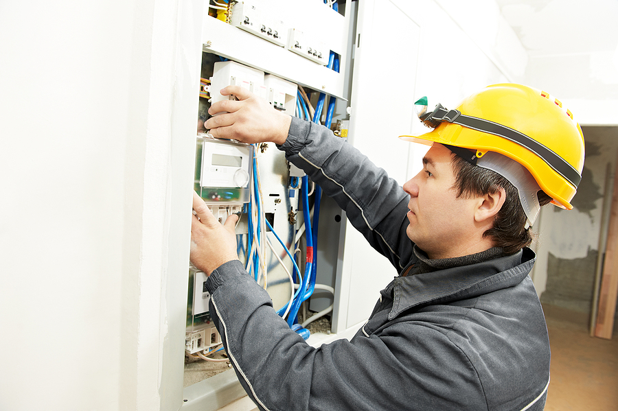 Telemetry solutions providers working remotely and installing a panel.