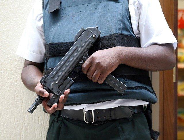 A bodyguard with a gun standing in Boca Raton Florida.