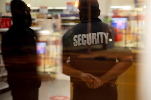 A security guard in Chicago protecting a store from a robbery.