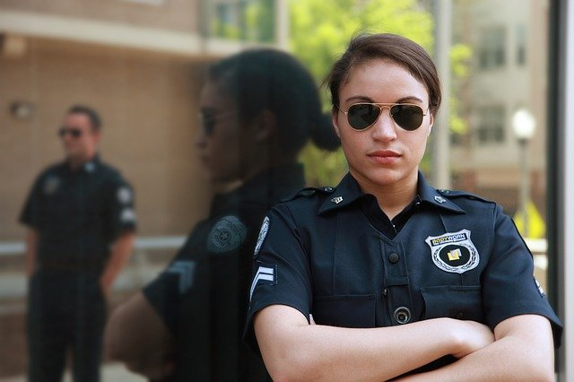 A guard from a security service in Oklahoma with her arms folded.